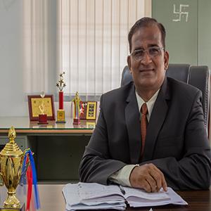 Dr. Anil Matkar,Director