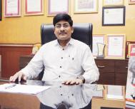 Dr. J. Girish